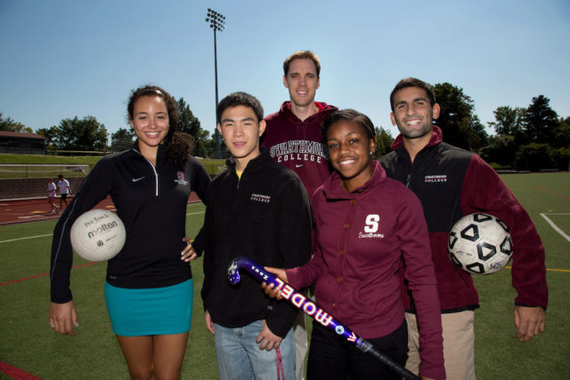Swarthmore College student athletes wearing college apparel and holding sporting equipment.